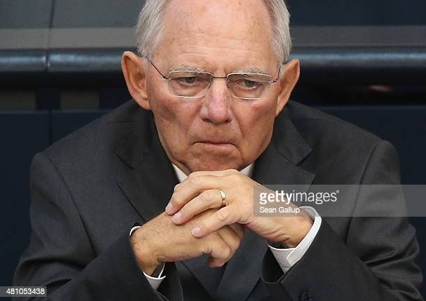 German Finance Minister Wolfgang Schaeuble attends debates prior to a vote over the third EU financial aid package to Greece at an extraordinary...