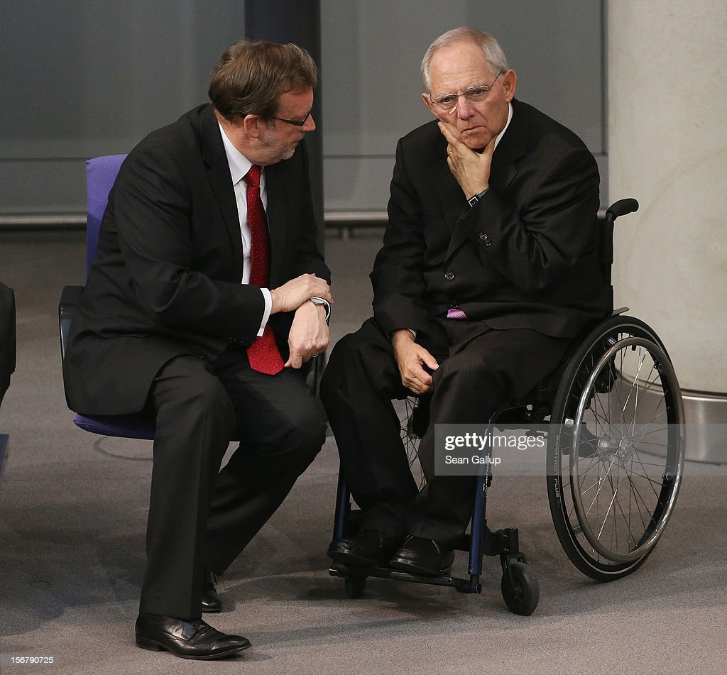 German Finance Minister Wolfgang Schaeuble (R) chats with Christian Democrat (CDU) Bundestag member Bernhard Kaster during debates at the Bundestag over the 2013 federal budget on November 21, 2012 in Berlin, Germany. Bundestag members are debating the budget over four days this week.