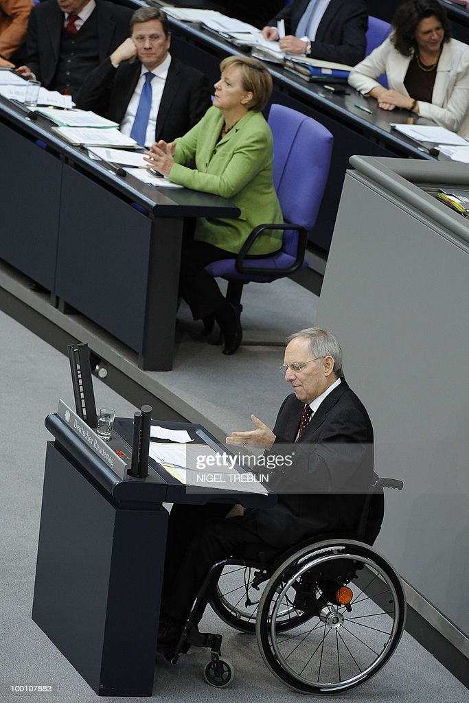 German Finance Minister Wolfgang Schaeuble delivers a speech as German Chancellor Angela Merkel and German Foreign Minister and vice-chancellor Guido Westerwelle (L) listen during a debate at the Bundestag, the lower house of parliament, on May 21, 2010 in Berlin. The German parliament is set to unblock its share of a trillion-dollar rescue package for debt-stricken eurozone countries , after Chancellor Angela Merkel warned the euro was 'in danger'.