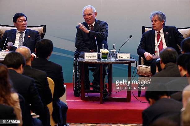 German Finance Minister Wolfgang Schaeuble delivers a statement as Chinese Finance Minister Lou Jiwei and International Monetary Fund First Deputy...