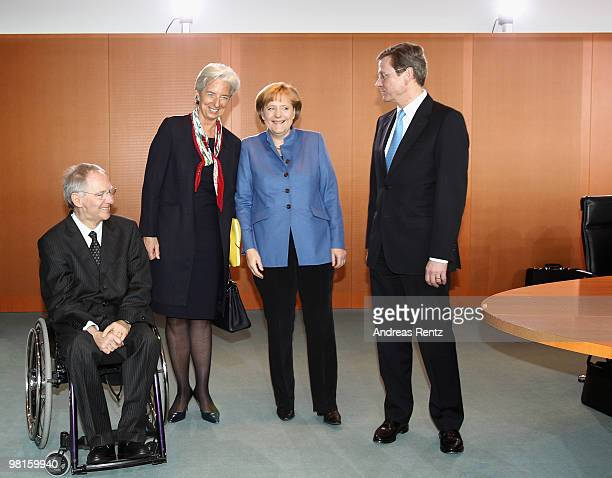 German Finance Minister Wolfgang Schaeuble French Minister for Economy Industry and Employment Christine Lagarde German Chancellor Angela Merkel and...