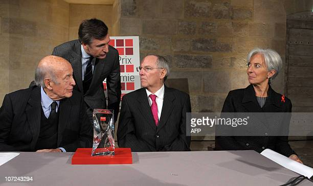 German Finance Minister Wolfgang Schaeuble listens to French Group Les Echos President Nicolas Beytout as former French President Valery Giscard...