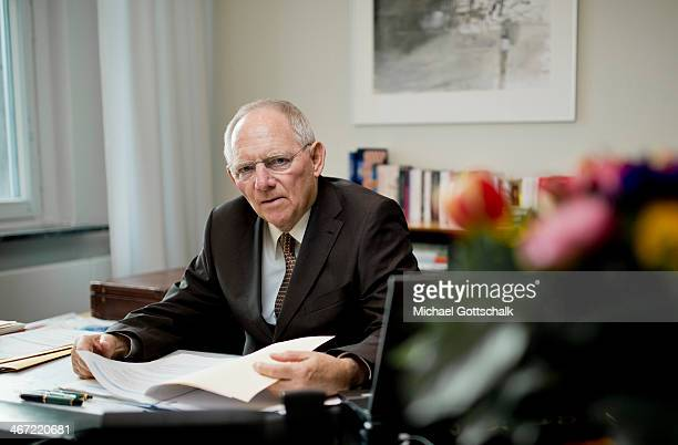 German Finance Minister Wolfgang Schaeuble sits behind his desk in his office in the finance ministry during a portrait session on February 06 2014...