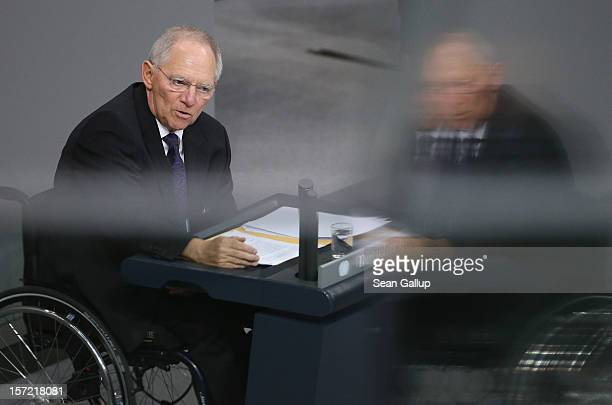 German Finance Minister Wolfgang Schaeuble speaks during debates over a financial aid package for stricken Greece at the Bundestag on November 30...