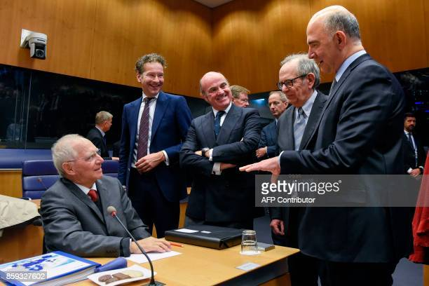 German Finance Minister Wolfgang Schaeuble talks with Dutch Finance Minister and President of the Eurogroup Jeroen Dijsselbloem Spain's Economy...