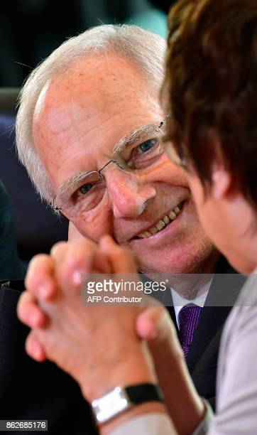 German Finance Minister Wolfgang Schaeuble talks with German Economy and Energy Minister Brigitte Zypries as they wait for the start of the the...
