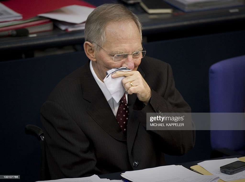German Finance Minister Wolfgang Schaeuble wipes his face during a debate at the Bundestag, the lower house of parliament, on May 21, 2010 in Berlin. The German parliament is set to unblock its share of a trillion-dollar rescue package for debt-stricken eurozone countries , after Chancellor Angela Merkel warned the euro was 'in danger'.