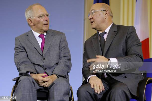 German Finance Minister Wolfgang Schauble and the French Finance Minister Michael Sapin talk to the media after their meeting on April 7 2014 in...