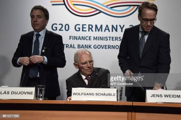 German Finance Minister Wolfgang Schauble German Bundesbank President Jens Weidman and Argentinian Treasury Minister Nicolas Dujovne give a press...