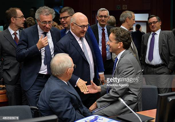 German Finance Minister Wolfgang Schauble Luxembourg's Finance Minister Pierre Gramegna French Finance Minister Michel Sapin and Eurogroup President...