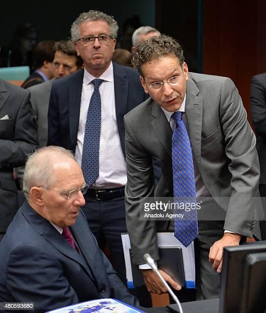 German Finance Minister Wolfgang Schauble Luxembourg's Finance Minister Pierre Gramegna and Eurogroup President Jeroen Dijsselbloem at the start of...