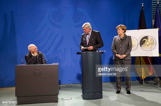 German Finance Minister Wolfgang Schäuble CDU presents the 2euro coins 25 Years of German Unity and Hessen German Chancellor Angela Merkel CDU and...