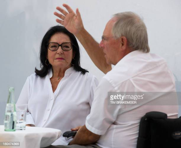 German Finance Minister Wolfgang Schäuble talks with Greek singer Nana Mouskouri during the Open House weekend of German ministries on August 18 2012...