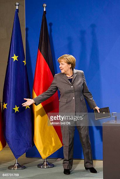 German Finance Minister Wolfgang_Schäuble CDU presents the 2euro coins 25 Years of German Unity and Hessen German Chancellor Angela Merkel CDU and...