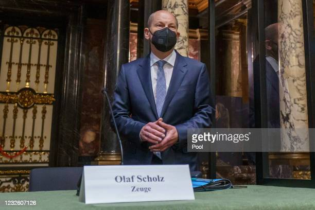 German Finance Minster and chancellor candidate of the German Social Democrats Olaf Scholz arrives to testify at the Hamburg state parliamentary...