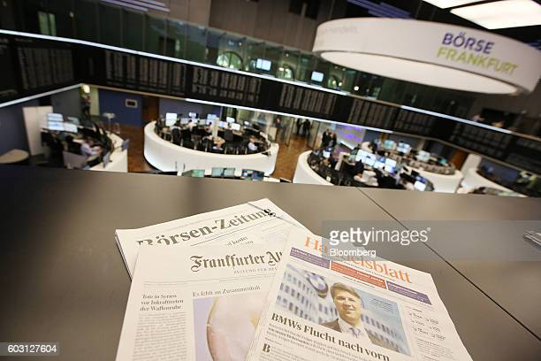 German financial newspapers sit inside the Frankfurt Stock Exchange in Frankfurt Germany on Monday Sept 12 2016 EON SE cut most ties to its legacy...
