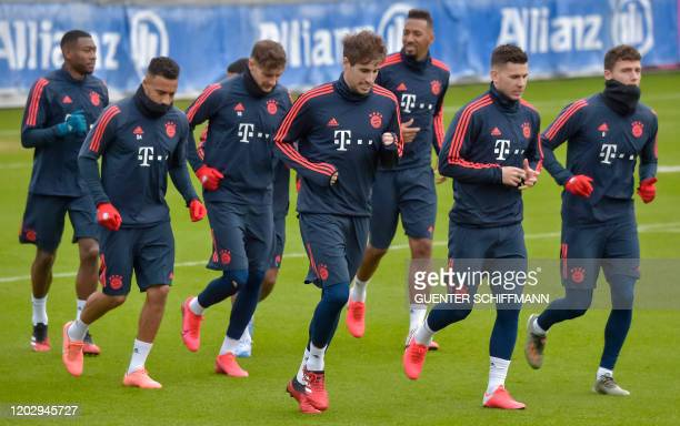 German first division Bundesliga football club Bayern Munich's players take part in a training session at the club's training area in Munich southern...