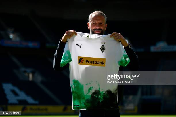 German first division Bundesliga football culb Borussia Moenchengladbach's new head coach Marco Rose poses with a jersey during a press conference at...