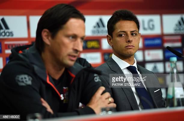 German first division Bundesliga team Bayer 04 Leverkusen's new Mexican forward Javier 'Chicharito' Hernandez and Leverkusen´s headcoach Roger...