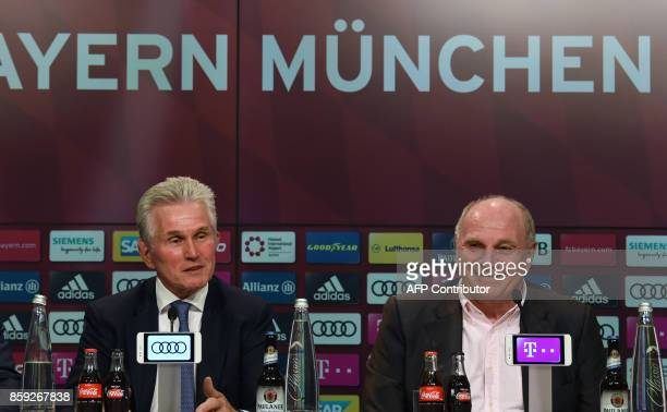 German first division club Bayern Munich's new head coach Jupp Heynckes and Bayern's president Uli Hoeness give a press conference following...