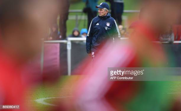 German first division club Bayern Munich's newlyappointed head coach Jupp Heynckes oversees a training session at the club's training camp in Munich...
