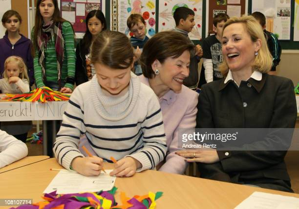 German First Lady Bettina Wulff and former First Lady Eva Luise Koehler sit togehther with scholars during their visit at the Lietzensee school on...