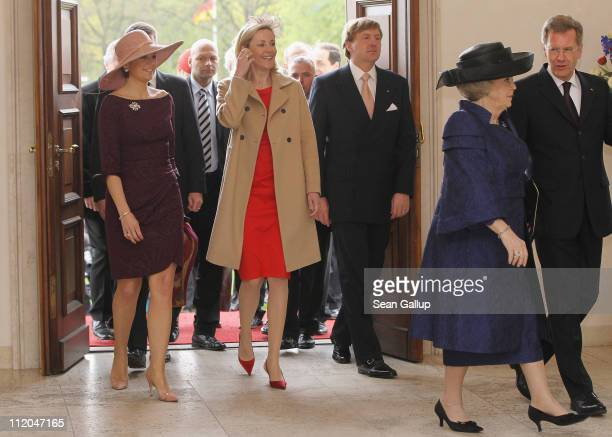 German First Lady Bettina Wulff and German President Christian Wulff welcome Princess Maxima , Prince Willem-Alexander and Queen Beatrix of the...