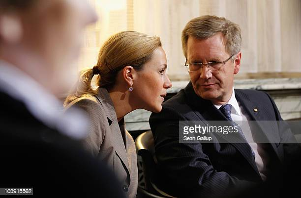 German First Lady Bettina Wulff and her husband President Christian Wulff attend a reception at the Swiss Parliament building on September 8 2010 in...