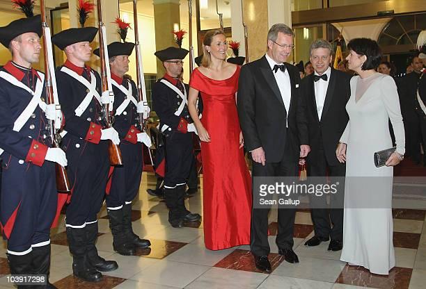 German First Lady Bettina Wulff German President Christian Wulff Swiss President Doris Leuthard and her husband Roland Hausin attend a state banquet...