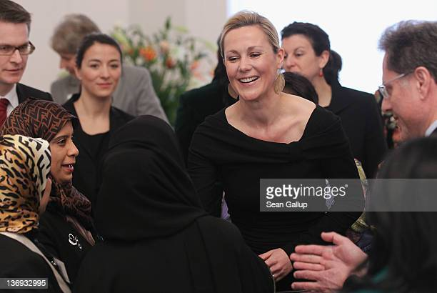 German First Lady Bettina Wulff greets the spouses of foreign diplomats at her annual reception for foreign diplomats' spouses at Schloss Bellevue...