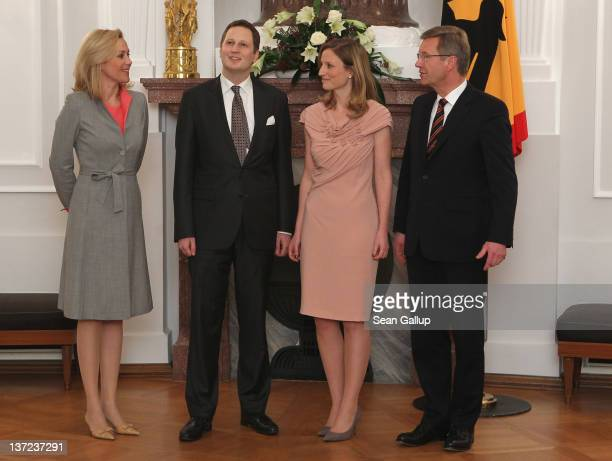 German First Lady Bettina Wulff, Prince Georg Friedrich Ferdinand of Prussia, Princess Sophie of Prussia and German President Christian Wulff pose...