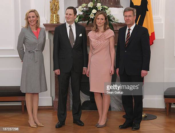 German First Lady Bettina Wulff Prince Georg Friedrich Ferdinand of Prussia Princess Sophie of Prussia and German President Christian Wulff pose for...