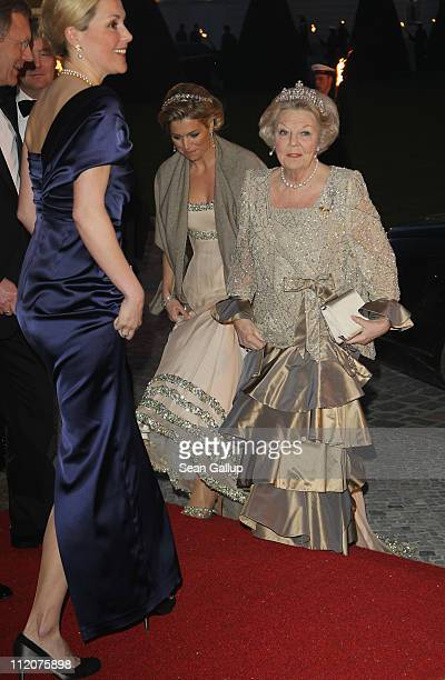 German First Lady Bettina Wulff Princess Maxima of the Netherlands and Queen Beatrix of the Netherlands attend a state banquet given in honour of the...
