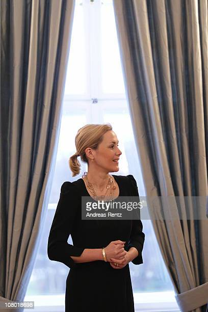 German First Lady Bettina Wulff smiles during the New Year's reception at Bellevue Palace on January 13, 2011 in Berlin, Germany. German President...
