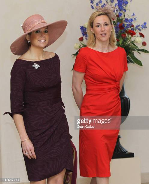 German First Lady Bettina Wulff welcomes Princess Maxima of the Netherlands at Bellevue Presidential Palace on April 12 2011 in Berlin Germany The...