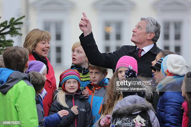 German First Lady Daniela Schadt and German President Joachim Gauck attend the christmas tree lighting ceremony at Bellevue Palace on November 28...