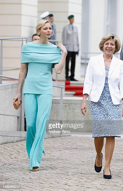 German First Lady Daniela Schadt chats with Princess Charlene of Monaco upon the arrival of the Monaco royal couple at Schloss Bellevue Palace on...