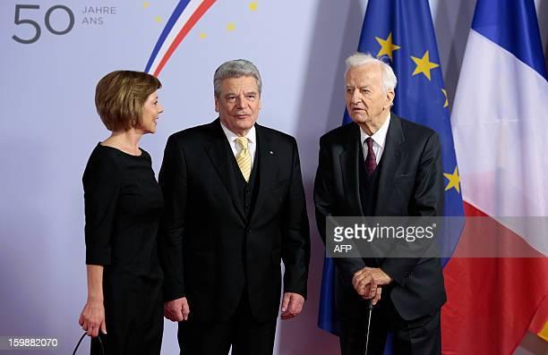 German First Lady Daniela Schadt, German President Joachim Gauck, and former German President Richard von Weizsaecker arrive for a concert at the...