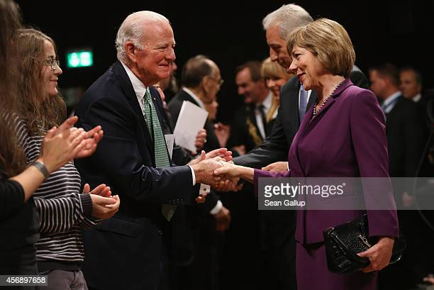 German First Lady Daniela Schadt greets former U.S. Secretary of State James Baker at the Gewandhaus concert hall prior to commemorations marking the...