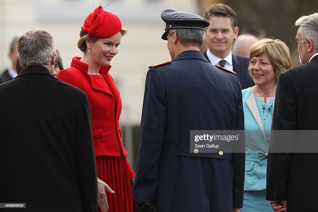 German First Lady Daniella Schadt (R) and Queen Mathilde of Belgium greet members of the German presidential office outside Schloss Bellevue on February 17, 2014 in Berlin, Germany. King Philippe and Queen Mathilde are in Berlin to attend a German-Belgian conference.