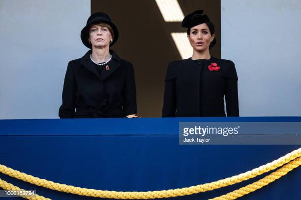 German FIrst Lady Elke Budenbender and Meghan Duchess of Sussex look on from a balcony during the annual Remembrance Sunday memorial at the Cenotaph...