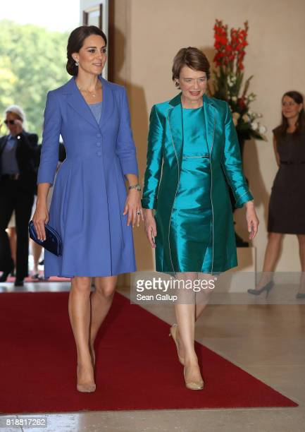 German First Lady Elke Buedenbender and Catherine Duchess of Cambridge chat at Schloss Bellevue presidential palace on the first day of the royal...