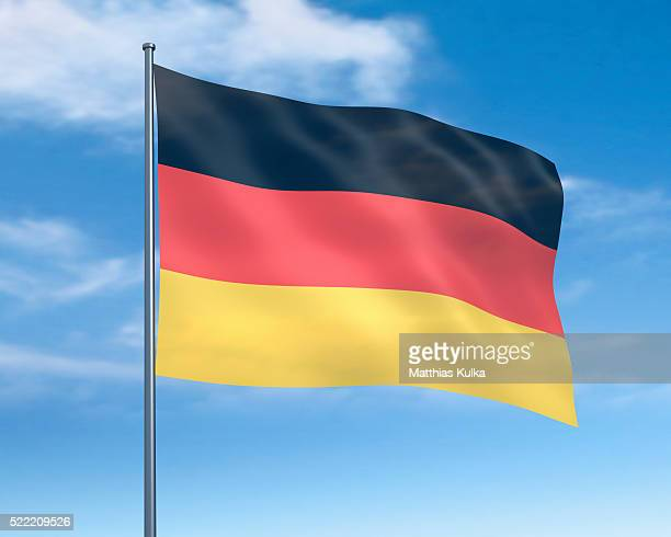 german flag against cloudy sky - german flag stock pictures, royalty-free photos & images