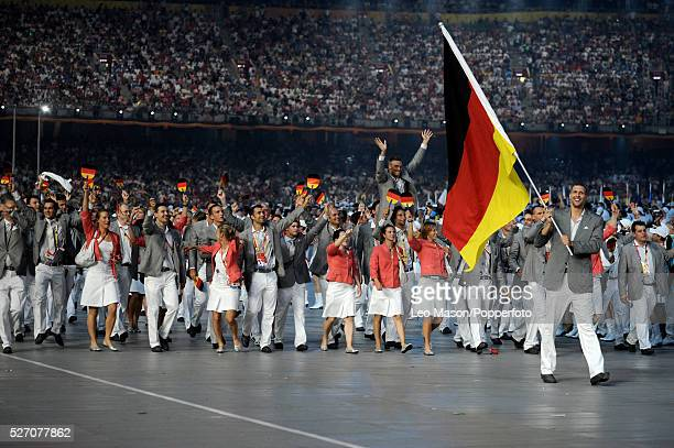 German flag bearer Dirk Nowitzki leads the team into the stadium during the Opening Ceremony of the Beijing 2008 Olympic Games at the National...