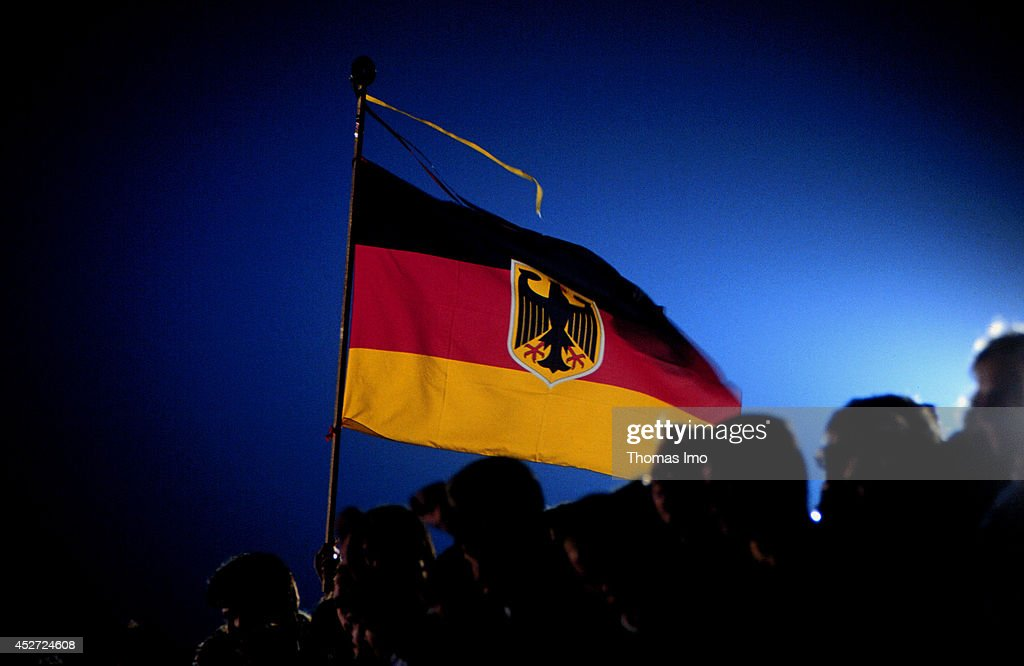 German Flag blowing in the wind on German Unity Day on October 03, 2014, in Berlin, Germany. The year 1990 marks the 25th anniversary of the fall of the Berlin Wall.