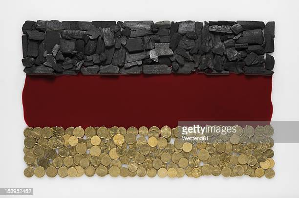 German flag created by coal, blood and coin on white background