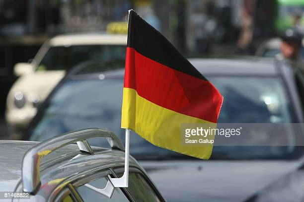 German flag flutters on top of a car driving in the city center on June 6 2008 in Berlin Germany Many German football fans are showing their...