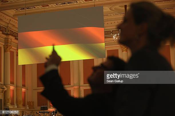 German flag hangs as guests arrive for celebrations to mark German Unity Day at the Semperoper opera house on October 3 2016 in Dresden Germany...