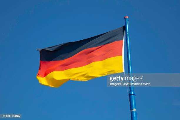 german flag in front of blue sky, lower saxony, germany - germania dell'ovest foto e immagini stock