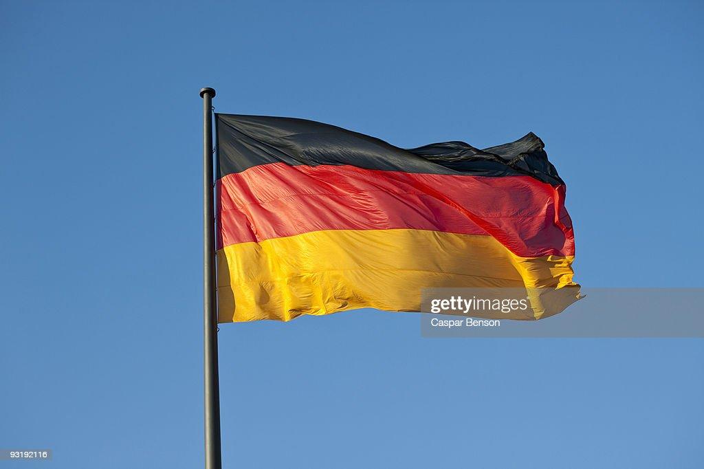 A German flag on a flag pole : Stock-Foto